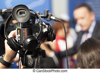 Filming an event with a video camera - Covering an event...
