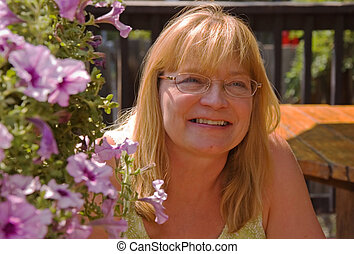 Carefree Happy Older Woman Outside - This middle aged blond...