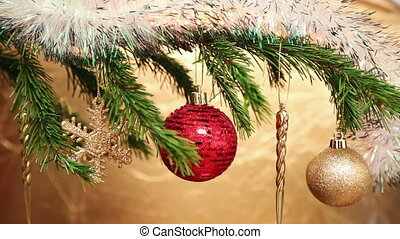 christmas holiday toys on fir tree twig and wood background...