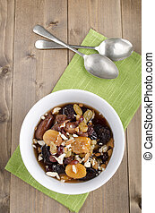 dried fruit compote with almond sliver and spoon