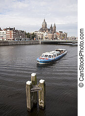 oosterdok in Amsterdam with tourist boat