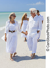 Four People Two Senior Family Couple Walking Tropical Beach...