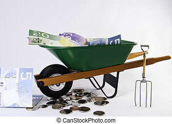 Wheel barrel and canadian dollars - Green wheel barrel with...
