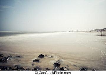 Minimalist misty seascape with rocks