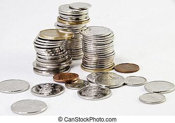 Stacks of Canadian Coins - Canadian coins stacked on a white...