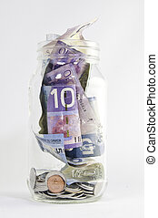 Canadian Dollars in Jar - Canadian dollars in jar with...