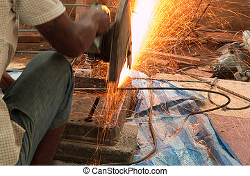 Man cutting and welding at work shop - Man cutting and...