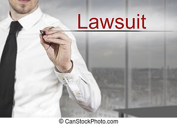 businessman writing in the air lawsuit - businessman in...