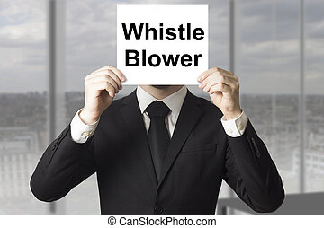 businessman hiding face behind sign whistle blower -...