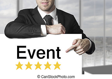 businessman pointing on sign event golden stars -...
