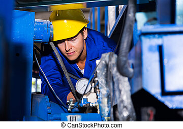 young industrial machine operator