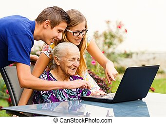 Grandmother's Success - Old grandmother using successfully...