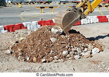 Caterpillar digging at a construction site - photo of...