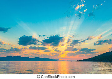 very beautiful sky in the rays of the rising sun over the sea