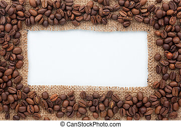 Frame of burlap and coffee beans lying on a white...