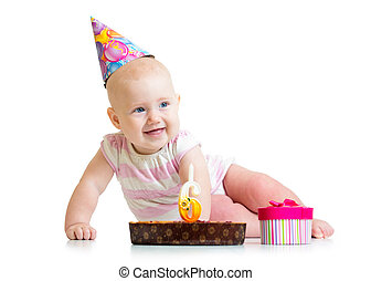 baby girl with birthday cake and gift box