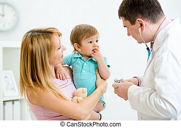 Puzzled or scared baby being checked by a doctor