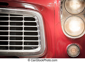 Close Up of Grille and Headlights of Red Vehicle