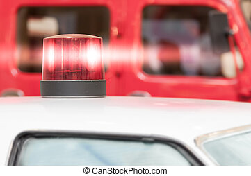 Flashing Red Siren Light on Roof of Vehicle - Detail of...