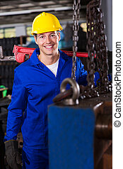 male industrial repairman in workshop - good looking male...