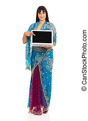 indian woman in sari pointing at laptop screen - pretty...