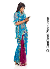 indian woman in sari using cell phone