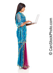 indian woman holding laptop computer