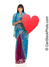 indian woman holding heart shape