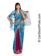 indian woman in saree carrying shopping bags on white...