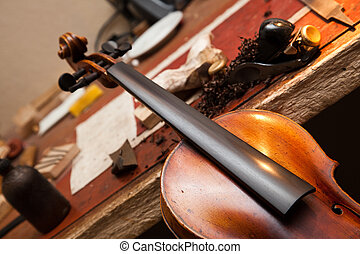 Violin repairs - Repairs being made on a violin in a...