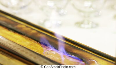 Fire on background glasses - Fire temperature maintaining of...
