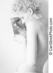 Young sexy girl and mirror, black and white photo