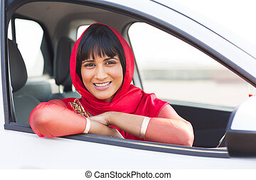 indian woman inside her new car