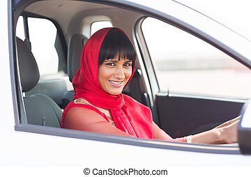 indian woman driver inside a car