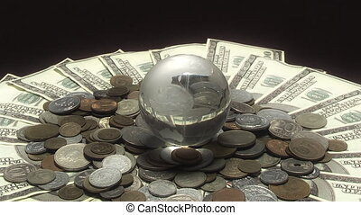 Globe rotates over money