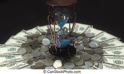 hourglass turns over money