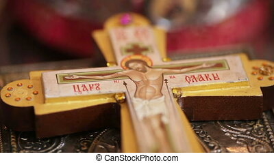Cross on tables - In the Church are on the table Bible and...