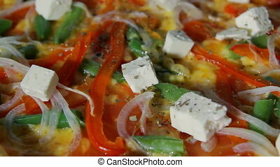 Chef sprinkling oregano on piza - Pizzaiolo sprinkling...