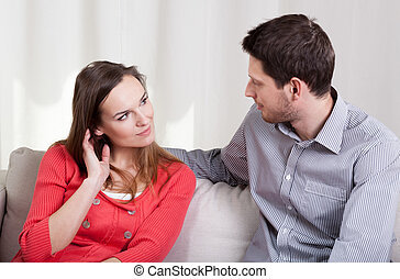 Young marriage on a couch - View of young marriage on a...