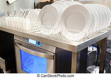 Dishwasher with white plates - image of a Dishwasher with...