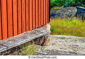 Red barn - Gable on a red wooden barn standing on granite...