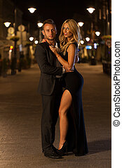 Beutiful couple and a city at night