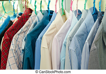 Clothes - colorful shirt rack on hanger in a row