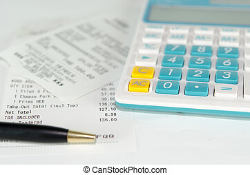 receipt paper and calculator - stock image of the receipt...