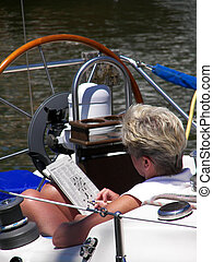 Leisure Time - Woman on a boat working a crossword puzzle.