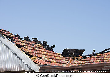 Chared timber beams on fire damaged roof of house - Fire...