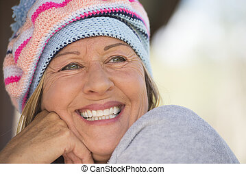 Friendly Woman with warm beanie hat in winter outdoor -...