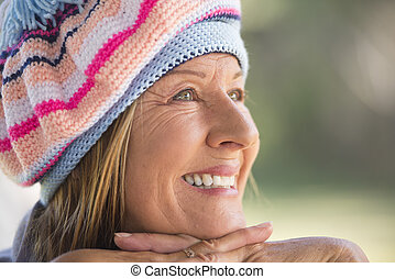 Woman with warm beanie cap winter - Portrait attractive...