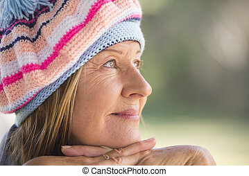 Woman with warm beanie cap winter outdoor - Portrait...