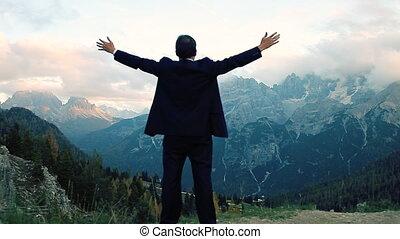 Cool businessman feeling freedom